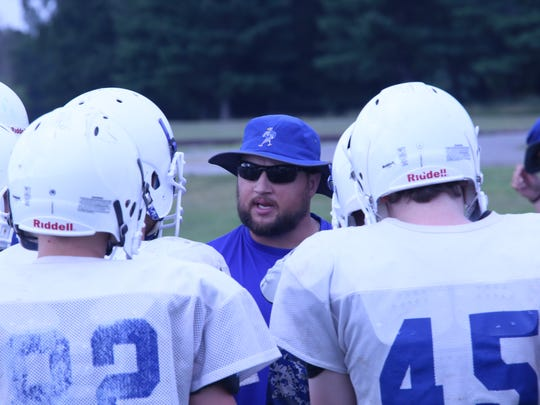 Fort Campbell coach Josh Robins talks with his team during a practice session Wednesday on post.