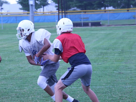 Fort Campbell's varsity team goes through practice Wednesday afternoon.