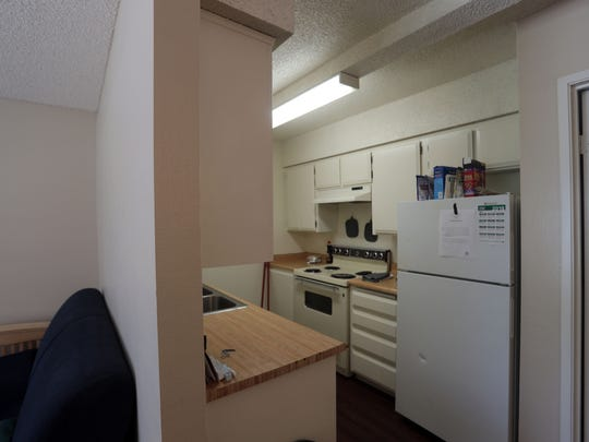 View of the kitchen at a Path of Life crisis housing unit located inside a apartment complex in Palm Desert on June 11, 2018.
