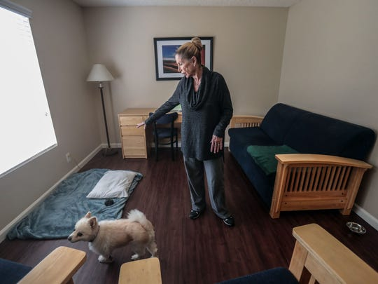 Mary Moore, 75, and her dog, Frisco, inside a Path