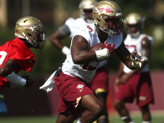 FSU's Jacques Patrick runs the ball during their opening