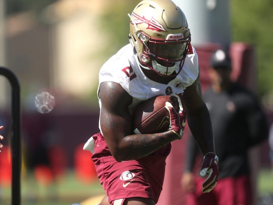 FSU's Khalan Laborn runs the ball during their opening practice for fall camp at the Al Dunlap Training Facility Monday, Aug. 6, 2018.