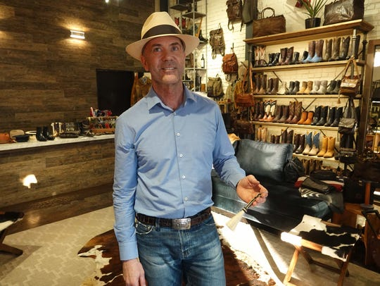 James Anderton, the owner of the West store in Beverly Hills, displaying a $20 trinket partially made from horse hair.