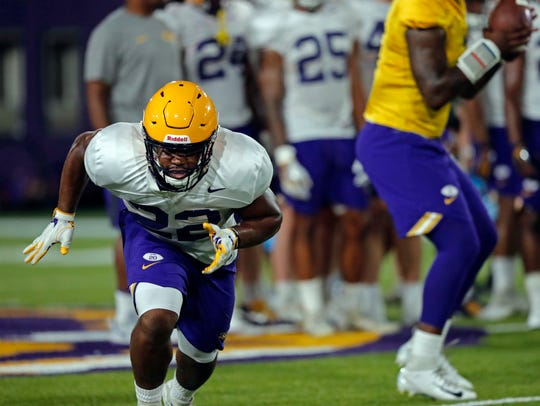 LSU running back Clyde Edwards-Helaire (22) goes through drills during practice Aug. 6 in Baton Rouge.