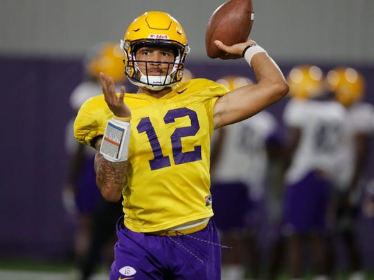 LSU quarterback Justin McMillan (12) passes during their NCAA college football practice in Baton Rouge, La., Monday, Aug. 6, 2018. (AP Photo/Gerald Herbert)