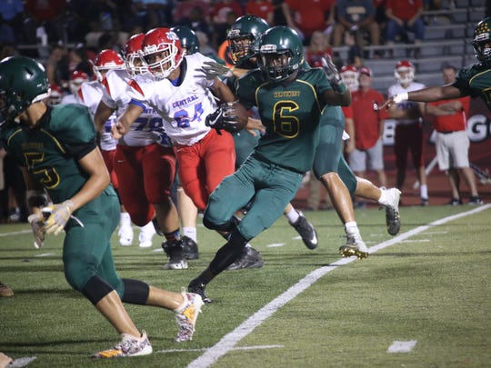 A Northwest runner tires to avoid Montgomery Central's