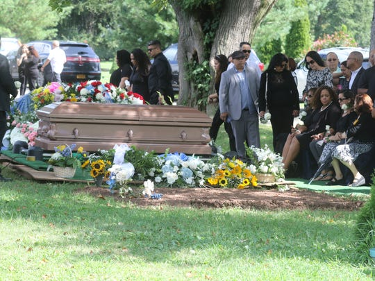 As mourners arrive the family of Zaida Polanco is seated at by the gravesite at the East Ridgelawn Cemetery in Clifton.