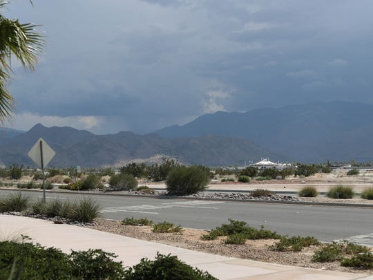 Dark clouds loom over the San Jacinto Mountains on