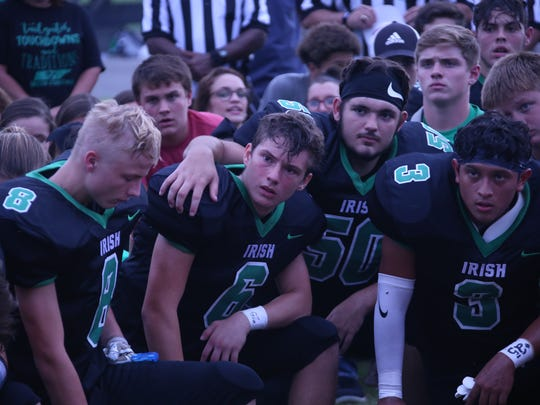 Houston County players listen to a prayer before the