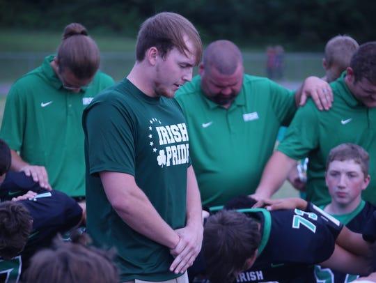 Trevor Hutchinson leads a prayer prior to the start