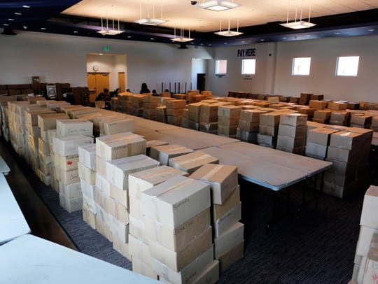 Thousands of books await unpacking Thursday in the