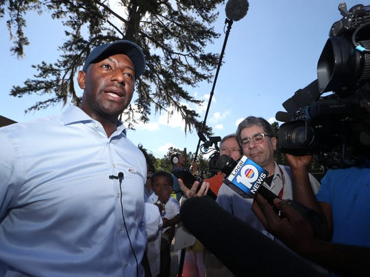 Gubernatorial candidate Andrew Gillum talks to the press after casting his vote at the Good Shepherd Catholic Church polling location Tuesday, Aug. 28, 2018.