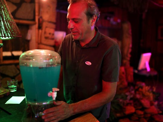 "Don Quarello prepares a batch of ""Blue Wave"" virgin cocktails during Bob Rackleff's watch party at Waterworks in Midtown on Tuesday, Aug. 28, 2018."