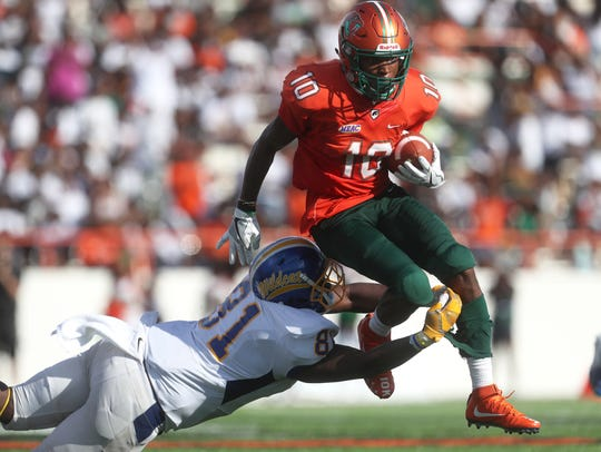 FAMU's Orlando McKinley leaps over Fort Valley State