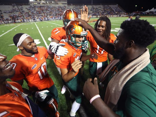 FAMU's Yahia Aly, center, is celebrated by his teammates after kicking a school record six field goals against Fort Valley State University as they open the season with a 41-7 win at Bragg Memorial Stadium on Saturday, Sept. 1, 2018.