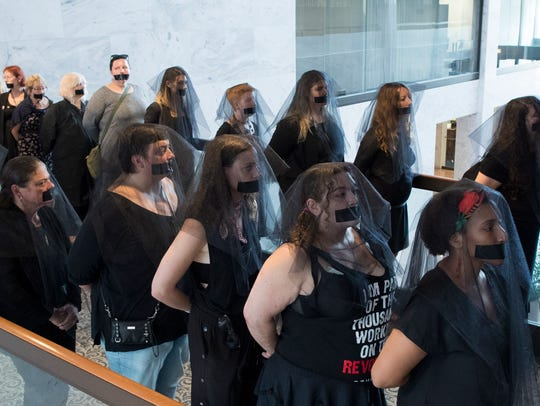Women's reproductive rights activists who oppose the nomination of Judge Brett Kavanaugh to the U.S. Supreme Court wear black veils and tape over their mouths outside the hearing room during the Senate Judiciary Committee's confirmation hearing on Kavanaugh, in Washington, D.C., Sept. 7, 2018. EPA-EFE/MICHAEL REYNOLDS