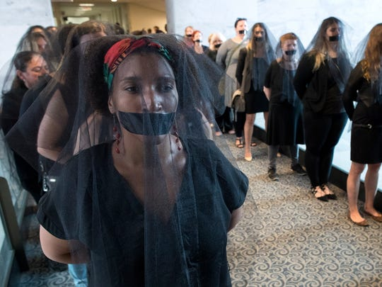 Women's reproductive rights activists opposed to the nomination of Judge Brett Kavanaugh to the U.S. Supreme Court protest wearing black veils and tape over their mouths outside the hearing room during the Senate Judiciary Committee's confirmation hearing in Washington, D.C., Sept. 7, 2018. President Trump nominated Kavanaugh to fill the seat of retiring justice Anthony Kennedy. EPA-EFE/MICHAEL REYNOLDS