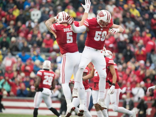 University of Wisconsin junior redshirt  linebacker Tyler Johnson (59) had reason to celebrate after the Menasha High School graduate received a scholarship from the Badgers this summer.