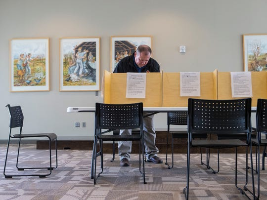 Mike Glovich votes in the Sioux Falls school $190 million bond election on Tuesday, Sept. 18, 2018 at Gloria Dei Lutheran Church in Sioux Falls, S.D.