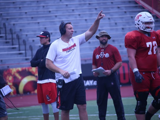 Austin Peay assistant Josh Eargle goes over a play