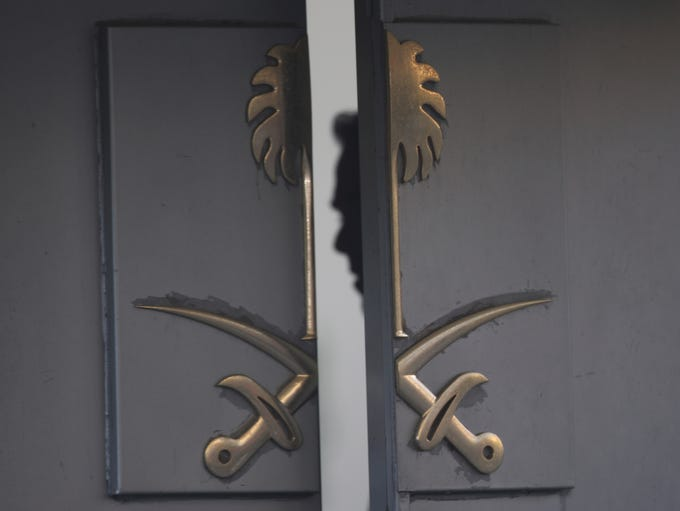 A security guard is seen inside the entrance of the