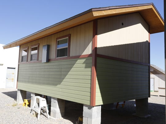 This 240-square-foot, cabin-style home with vaulted