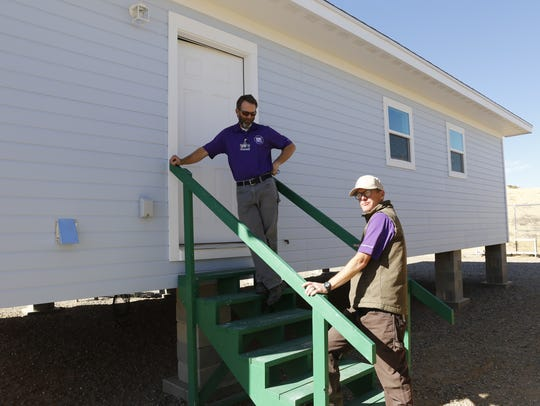 Chad Triplett, left, and Zachary Pettijohn of the building