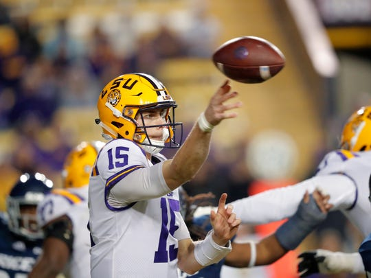 LSU quarterback Myles Brennan (15) passes in the second
