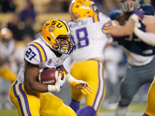 LSU running back Lanard Fournette (27) carries in the second half of an NCAA college football game against Rice in Baton Rouge, La., Saturday, Nov. 17, 2018. (AP Photo/Gerald Herbert)