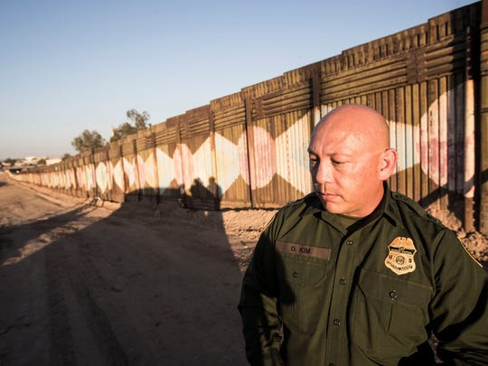 Customs and Border Protection agent David Kim patrols the Calexico/Mexicali international border wall on June 19, 2018.