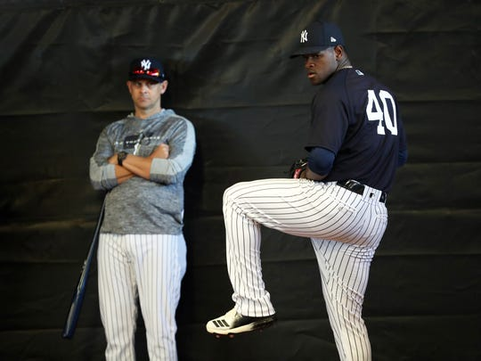 Feb 14, 2019; Tampa, FL, USA;New York Yankees starting pitcher Luis Severino (40) throws a bullpen session as manager Aaron Boone (17) looks on during spring training at George M. Steinbrenner Field. Mandatory Credit: Kim Klement-USA TODAY Sports