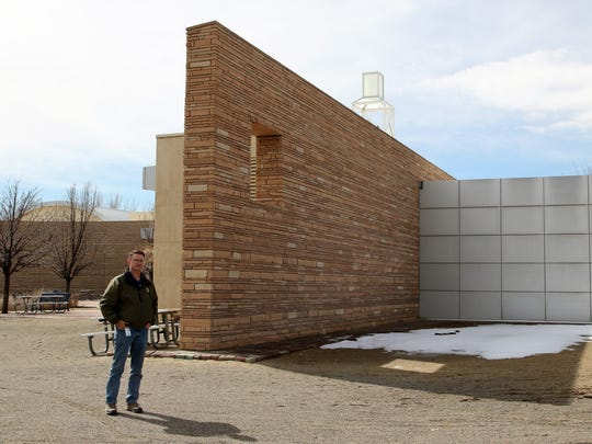 Farmington Museum director Bart Wilsey stands at the northeast corner of the building where a 2007 conceptual plan indicated a traveling exhibition hall and auditorium could be constructed.