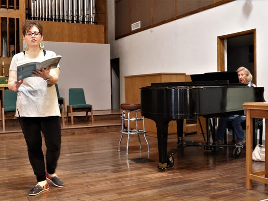 """Vocalist Amber Jones, left, and director Linda Edwards run through a portion of """"Stabat Mater"""" on Wednesday at RiverStone Church in Farmington, where the piece will be performed later this month."""