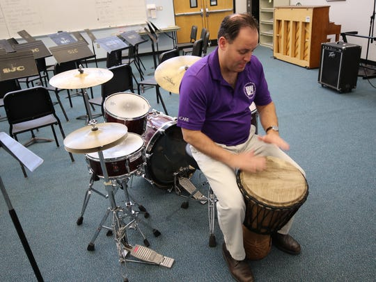 San Juan College music professor Teun Fetz plays a