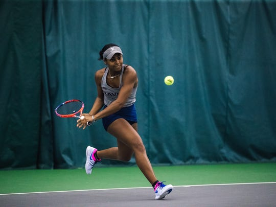 Xavier University first singles player Ahmeir Kyle serves against Cincinnati in a women's tennis match on Sunday, April 7, 2019.