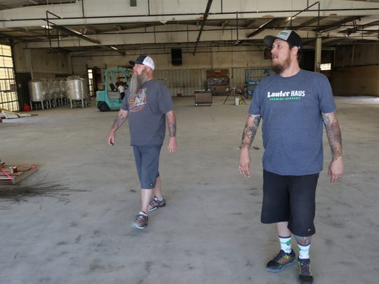 Owner and brew master Brandon Beard, right, expects construction at the Lauter Haus Brewing Company to be completed by July.