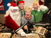 On Tuesday, Nov. 15, KESZ-FM will switch over to an all-holiday format. Radio personality Beth McDonald is surrounded by radio cohorts Marty Manning (from left), Chad Mitchell and Cory McCloskey from Channel 10 (KSAZ).