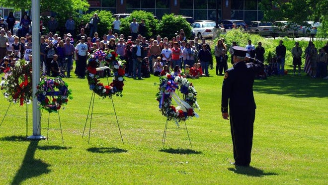 A wreath-laying ceremony at Webster Rural Cemetery last year honors the wars' fallen.