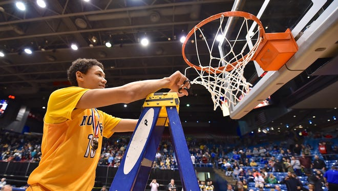 Jaxson Hayes cuts part of the net for Moeller March 11th at the University of Dayton.