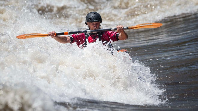 Sonny Shepherd of Lake Mills, Iowa, rides a trough in the dam feature at the Charles City, Iowa, WhiteWater Riverfront Park Friday June 17, 2016, on the Cedar River.