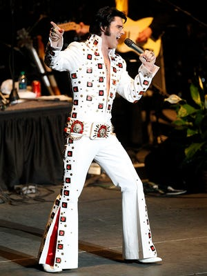 """In this Saturday, June 6, 2015 photo, Diogo """"Di Light"""" Leichtweis, of Porto Alegre, Brazil, performs during the annual Elvis Presley Festival in Tupelo Miss. """"Elvis is huge in Brazil. People love his movies, especially 'Blue Hawaii,'"""" Leichtweis said. """"Since I was a kid, my father has been a huge fan."""" Elvis Week is Aug. 8-16 in Memphis, Tennessee."""