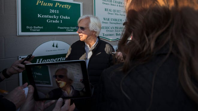 Trainer Bob Baffert is surrounded by media following a workout by Kentucky Derby favorite Justify. May 1, 2018.