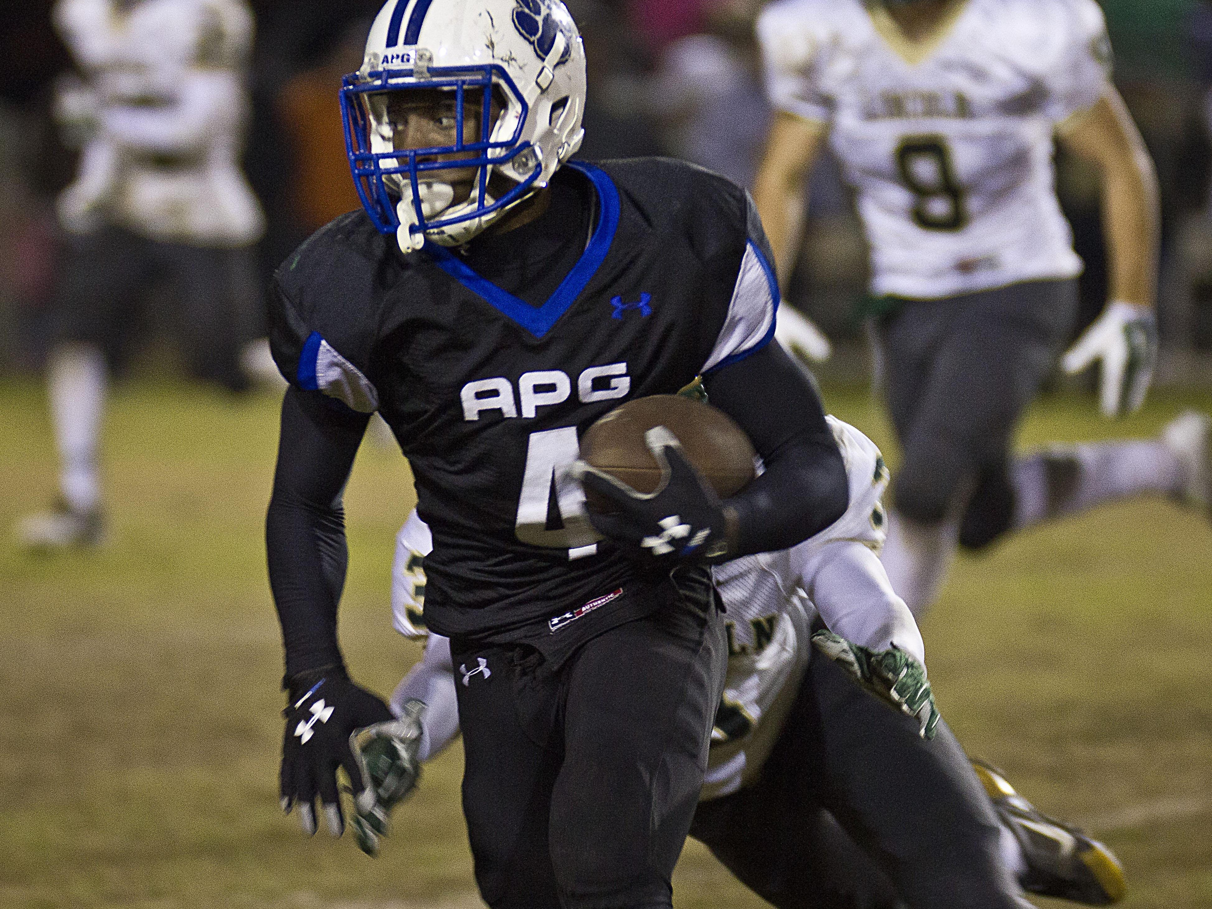Godby Cougars running back P.J. Simmons rushes for a first down against Lincoln at Gene Cox Stadium during last year's 22-17 win. Simmons rushed for 96 yards and a touchdown in the defensive game.