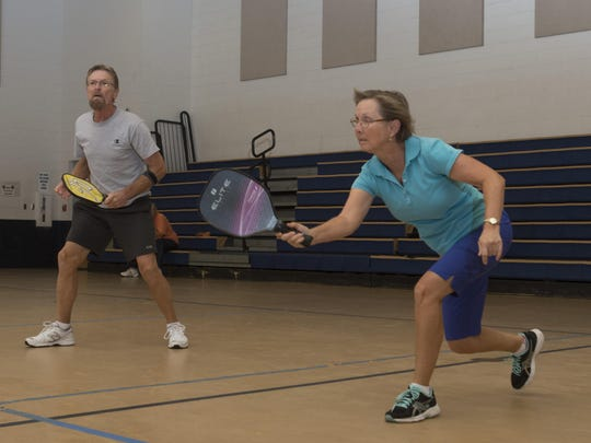 John and Lisa Severson play a doubles match of pickleball at the Guy Thompson Community Center in Milton on Friday morning.