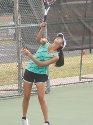 Van Buren's Emily Saniseng serves during practice on Wednesday morning at the Van Buren Tennis Courts. Saniseng is one of the two captains for the Pointer team this season which begins on Aug. 17 in a match with Northside.