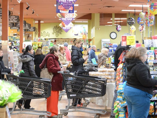 A line of shoppers stocking up for Winter Storm Stella