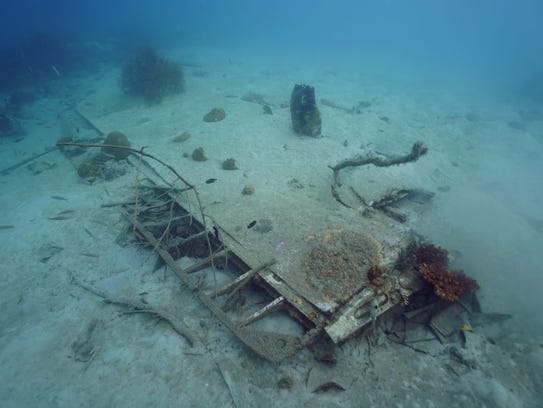 Wreckage from a B-25 bomber is strewn across the ocean