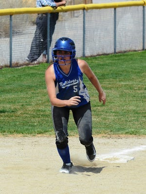 Smith Valley junior Tania Covarrubias gets a jump off third base, a few pitches before scampering home on a Wells wild pitch during Saturday's home doubleheader.