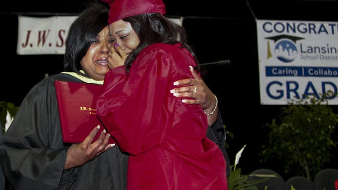 Class of 2015 Sexton graduate Jocelyn Chapman and her mom, Lansing School District's Magnet Schools coordinator Delsa Chapman share an emotional moment during Sexton's Commencement before Delsa handed her daughter her diploma at Lansing Eastern's Don Johnson Fieldhouse on May 30.