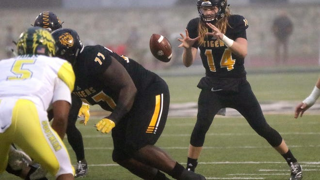 Fort Hays State University quarterback Chance Fuller takes the snap for a play against Missouri Southern last season at Lewis Field Stadium in Hays.